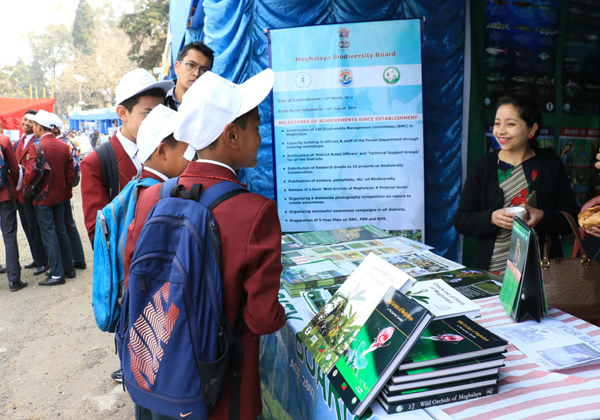 Staff of Meghalaya Biodiversity Board distribute posters, pamplets etc to school students