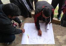 A villager drawing a map